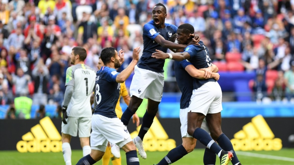 Paul Pogba celebrates with his teammates after scoring the winning goal for France in the 80th minute
