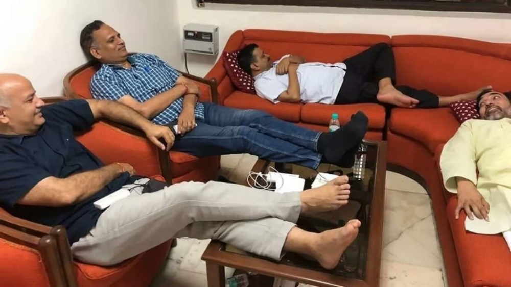 Delhi CM Arvind Kejriwal sits on a Dharna with his AAP colleagues at the LG office