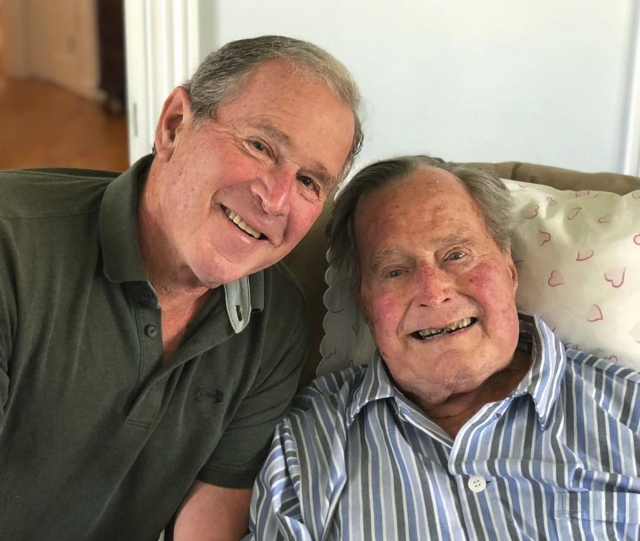 Former US presidents George HW Bush (right) and his son George Bush pose for a photo in Kennebunkport, Maine. Bush senior enjoyed a relaxing birthday on Tuesday as he became the first former US president to turn 94.