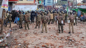 Securitymen stand guard a street during curfew in Shillong on Saturday