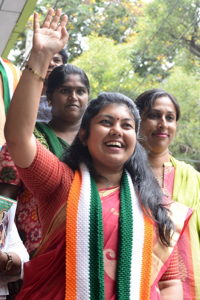 Congress candidate Sowmya Reddy, who won from Bengaluru's Jayanagar Assembly constituency in Bengaluru, waves to her supporters after the announcement of results.