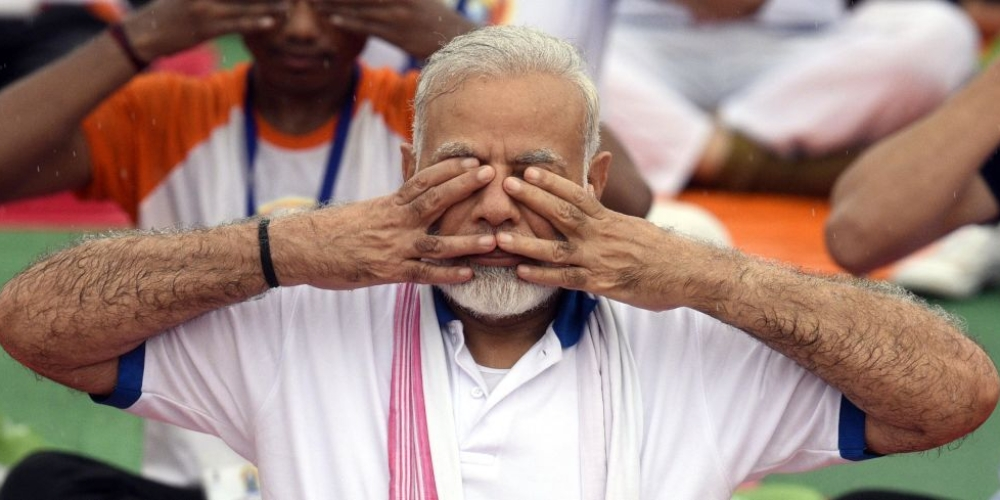 Prime Minister Narendra Modi takes part in yoga on International Yoga Day on June 21, 2017 in Lucknow