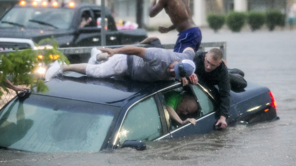 Work to rescue Bruce Salley, who was trapped in his car by flood waters in a supermarket parking in Rockford.