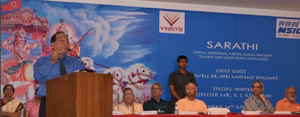 A file photo of DS Kulkarni addressing a gathering, as RSS chief Mohan Bhagwat (third from right) is seated on the stage