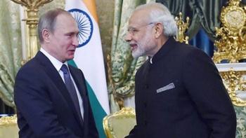 File photo of Russian President Vladimir Putin with Prime Minister Modi