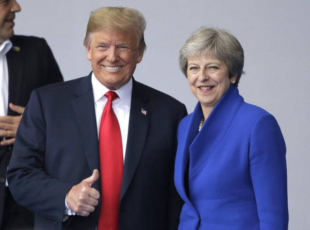 US President Donald Trump, left, with British Prime Minister Theresa May during a summit of heads of state and government at NATO headquarters in Brussels.