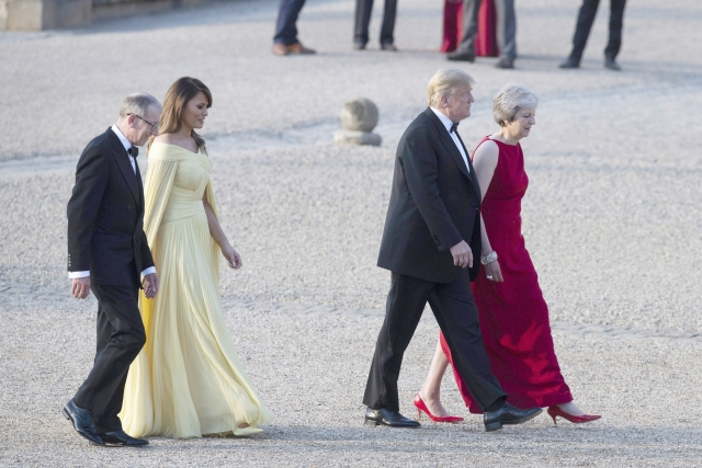 President Donald Trump, British Prime Minister Theresa May, front and first lady Melania Trump, and May's husband Philip May, arrive at Blenheim Palace, in Blenheim west of London, England.