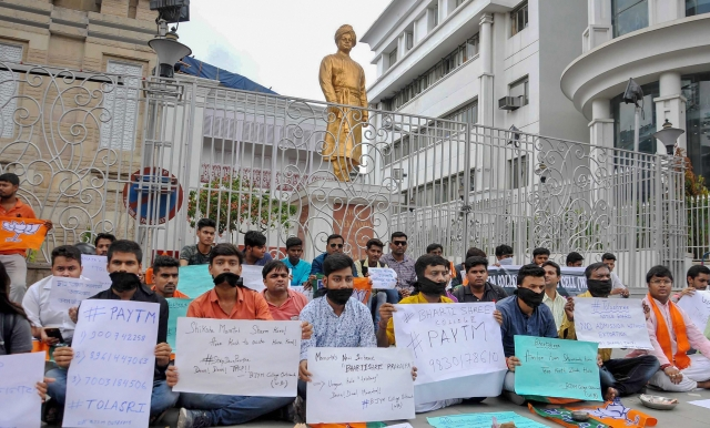 Members of Bharatiya Janata Yuva Morcha (BJYM) stage a silent protest infront of Swami Vivekananda's ancestral house against the state government over the alleged cases of corruption during college and university admissions, in Kolkata.
