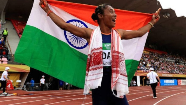 Hima Das celebrates after winning gold in women's 400m at the IAAF World U-20 Championships