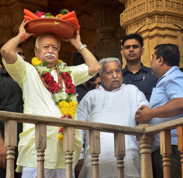 RSS chief Mohan Bhagwat and former BJP leader Keshubhai Patel before performing prayers at Somnath Temple in Gujarat.