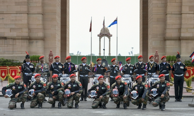 Members of the Indian Army's Shwet Ashwa team pose for a group photo at India Gate, on their arrival for the celebrations of Kargil War victory, in New Delhi.