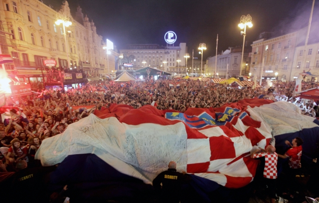 Croatia fans celebrate at the end of the semifinal match between Croatia and England, in Zagreb, Croatia.