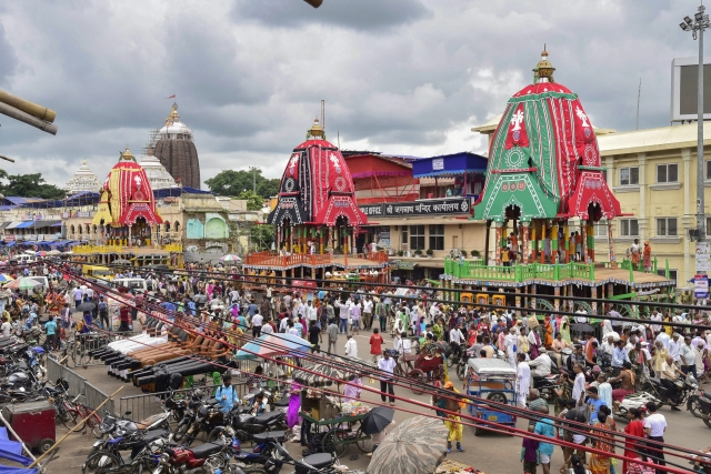 Chariots of Lord Jagannath, Lord Balabhadra, and Goddess Subhadra during the final leg of preparation ahead of Rath Yatra festival, in Puri.