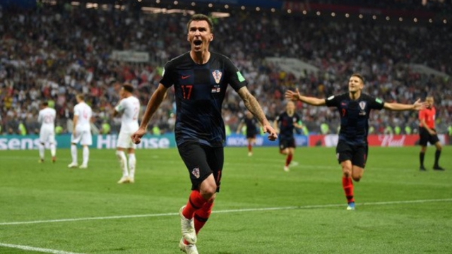 Mario Mandzukiz celebrates his goal in the 109th minute that led Croatia to its first ever World Cup final