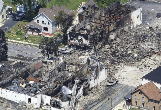 In a view looking northwest from above, the aftermath of a gas explosion in downtown Sun Prairie, Wis., is seen. At the top right of the image is the site of the former Barr House where the explosion originated and leveled the building. Sun Prairie Fire Department Capt. Cory Barr was killed Tuesday when a natural gas explosion leveled most of a city block, including the tavern Barr owned.