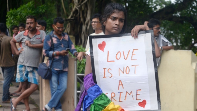 A participant holds a banner against criminalisation of same sex relations under Section 377 IPC in India,  at Chandannagar, West Bengal (file photo)