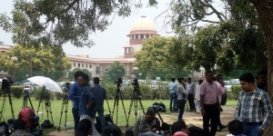 Media persons wait outside the Supreme Court during the hearing on petitions against Section 377 of the Indian Penal Code, that criminalises same sex relations regardless of consent (file photo)