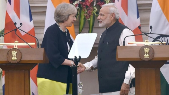 File photo of Indian Prime Minister Narendra Modi with British PM Theresa May (representational image)