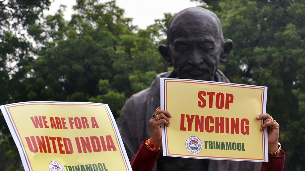 Trinamool Congress MPs demonstrate against increasing incidents of lynching in front of Mahatma Gandhi statue at Parliament, in New Delhi on July 24, 2018. Representative image
