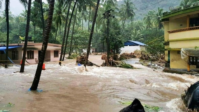 A view of partially submerged houses in rain water, at flood affected areas, in Thiruvananthapuram, Kerala