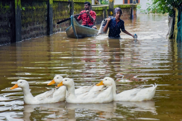 A view of a flooded locality after heavy rains, at Elloor in Kochi.