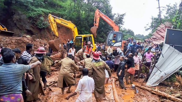 Rescue operations being carried out following a landslide, triggered by heavy rains at Adimali, in Idukki, Kerala