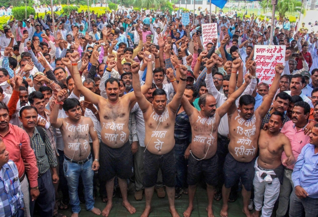 Madhya Pradesh Panchayat Sachiv Sanghthan activists stage a protest to press for the implementation of seventh pay scale and various other demands, in Bhopal.