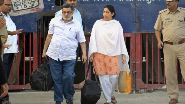 Aarushi Talwar's parents Rajesh and Nupur Talwar walk out of Dasna jail in Ghaziabad on October 16, 2017, after Allahabad High Court acquitted them of the murder of Aarushi and their domestic help Hemraj Banjade