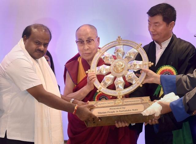 Tibetan spiritual leader Dalai Lama presents a traditional Tibetan memento to  Karnataka Chief Minister HD Kumaraswamy during a programme in Bengaluru.