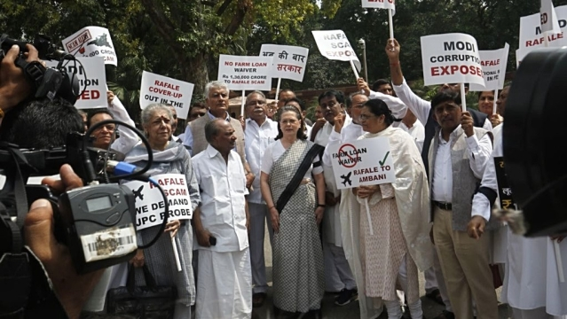 Congress leader Sonia Gandhi along with other Opposition MPs during a protest against the Rafale fighter jet deal, outside Parliament on Friday, August 10