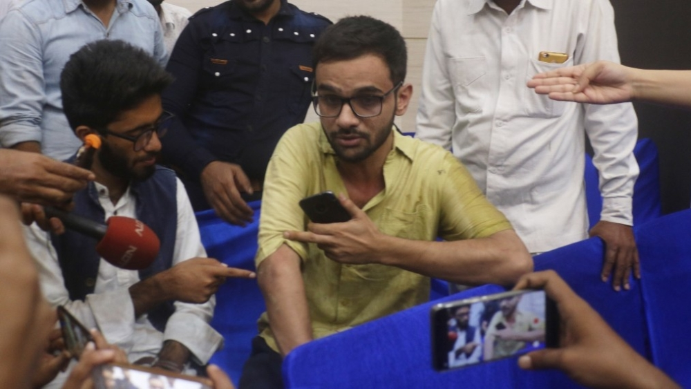 Jawaharlal Nehru University scholar Umar Khalid addresses a press conference in New Delhi on Monday, August 13, after an unidentified man opened fire at the JNU scholar outside central Delhi's Constitution Club, according to police. Khalid escaped unhurt. Khalid was at the Constitution Club to attend a 'United Against Hate' programme