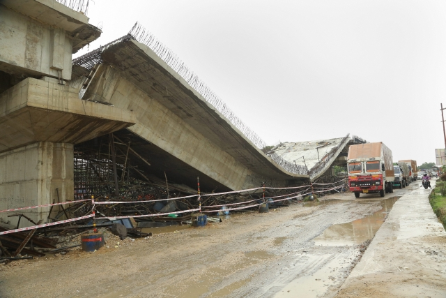 An underconstruction flyover collapses in Basti district.