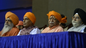 File photo of Rashtriya Swayamsevak Sangh chief Mohan Bhagwat (second from right) with Union Home Minister Rajnath Singh (second from left)