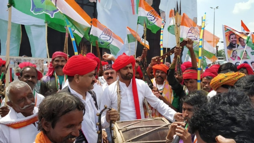 Congress workers in Bhopal, Madhya Pradesh on September 17 during Congress President Rahul Gandhi's road show to launch the party's campaign for the upcoming assembly elections
