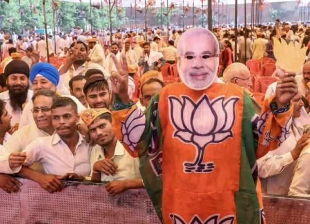 BJP supporters flaunting Modi-mask  in a rally in Shamli, UP