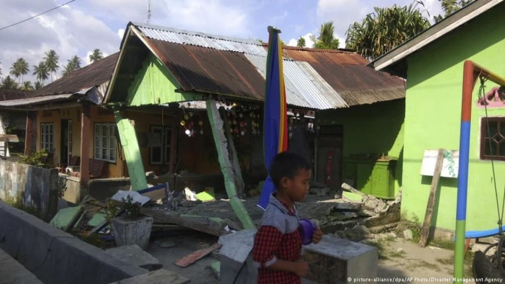 The tsunami up to two meters tall swept way houses in Palu, the capital of central Sulawesi province