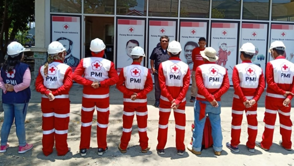 Indonesian Red Cross workers gear up to provide relief after a tsunami which followed a powerful earthquake struck the island of Sulawesi