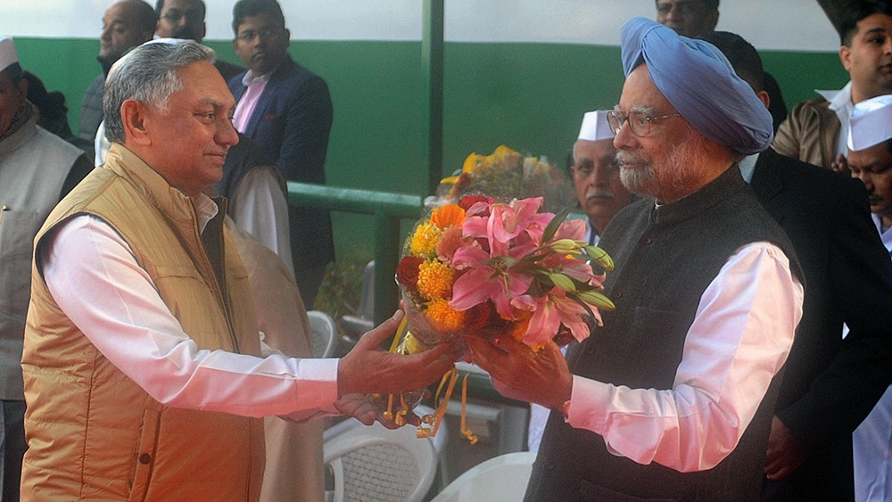 Congress leader Janardan Dwivedi (left) greets former Prime Minster Dr Manmohan Singh (file photo)