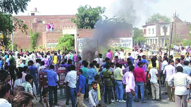 Villagers vandalise properties and resort to arson in Mainpuri district over rumours of cow slaughter in the area.