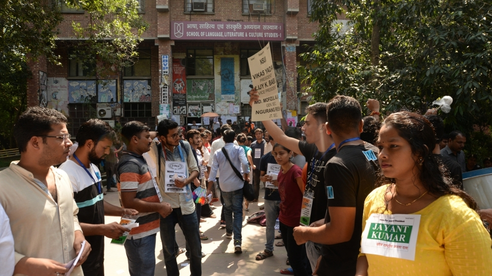 Students of various organisations raise slogans in support of their candidates during JNU Students' Union elections in New Delhi on September 14, 2018