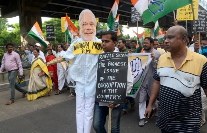 Congress workers hold an effigy of Prime Minster Narendra Modi during a protest in Kolkata against the alleged scam in Rafale deal (file photo)