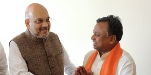 Chhattisgarh State Congress working president and MLA, Ramdayal Uike with BJP president Amit Shah after joining the ruling party, in Bilaspur on Saturday.