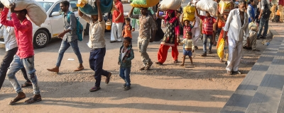 Migrant workers from Uttar Pradesh and Bihar leave for their homes after violence broke out over the alleged rape of a 14-month-old girl in Ahmedabad