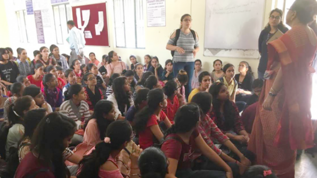 Students protesting at Bharati College demanding action against the professor; Principal Mukti Sanyal (orange sari) can be seen on the right hand side