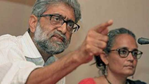 What is the Bhima Koregaon case for which Gautam Navlakha, other activists are facing trial?