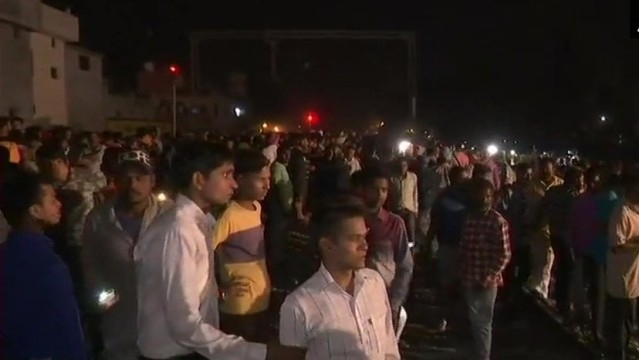 Train mows down crowd at India festival, at least 50 dead
