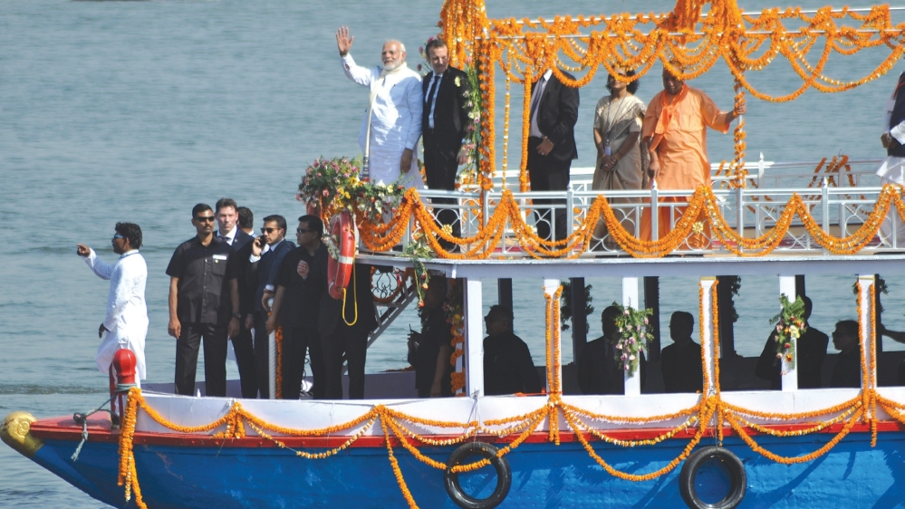 PM Modi, accompanied by French President Emmanuel Macron, on a river cruise on the Ganga in Varanasi earlier this year