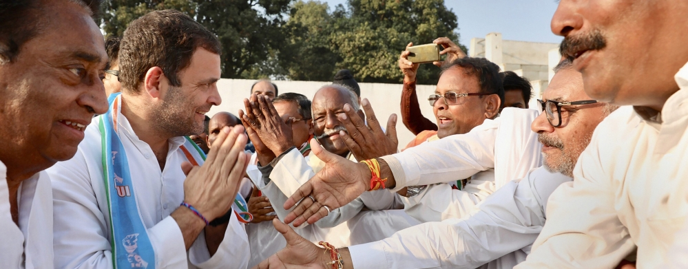 Congress President Rahul Gandhi meets party supporters and workers during a public rally at Mahatma Gandhi Stadium Ground ahead of the State Assembly elections in Mandla district,