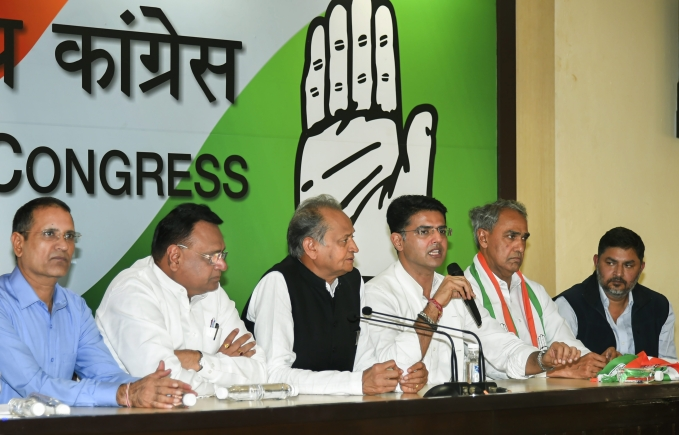 Rajasthan Congress chief Sachin Pilot speaks during a press conference after BJP MP from Dausa Harish Chandra Meena (2nd R) joined the Congress party, at AICC headquarter in New Delhi, Wednesday, Nov 14, 2018. Senior leader and former Rajasthan CM Ashok Gehlot is also seen.