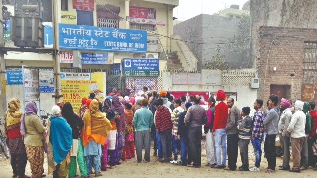 Despite cold weather in North India, people queued up outside their bank branches to get cash in the winter of 2016